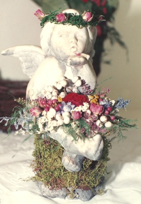 Angel decorated with dried flowers. By Keiko Nakaumura