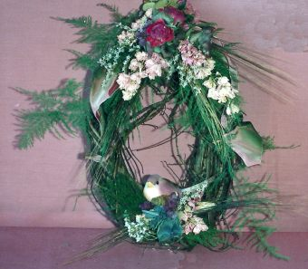 Hanging wreath with mushroom bird.