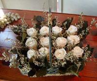 Preserved white roses
