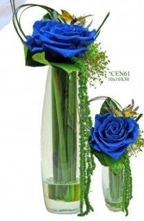 Blue preserved roses in glass