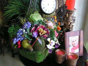 Moss basket with fruits and flowers