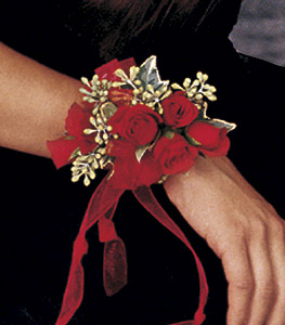 Red mini roses corsage with accents of of eucalyptus berries and ribbon