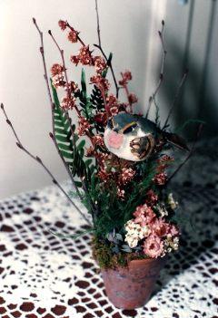 Terracotta pot with mushroom bird