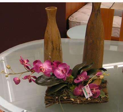 Purple silk orchids in natural container.