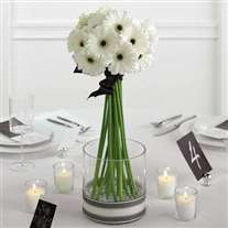 Wedding flower arrangement with white gerbera in glass vase