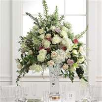 Wedding flower arrangement in glass vase