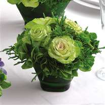 Wedding flower centerpiece. Green cabbage roses in glass vase
