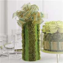 Wedding flower centerpiece. Green tones. Vase covered with fabric and flowers