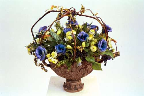 Ranunculus and wild flowers basket
