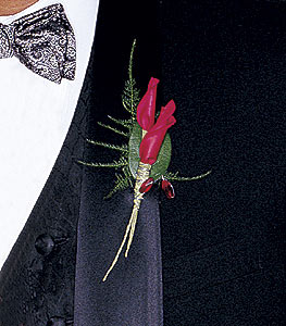 Boutonnière made with rolled rose petals and foliage