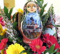 Russian doll and gerbera daisies